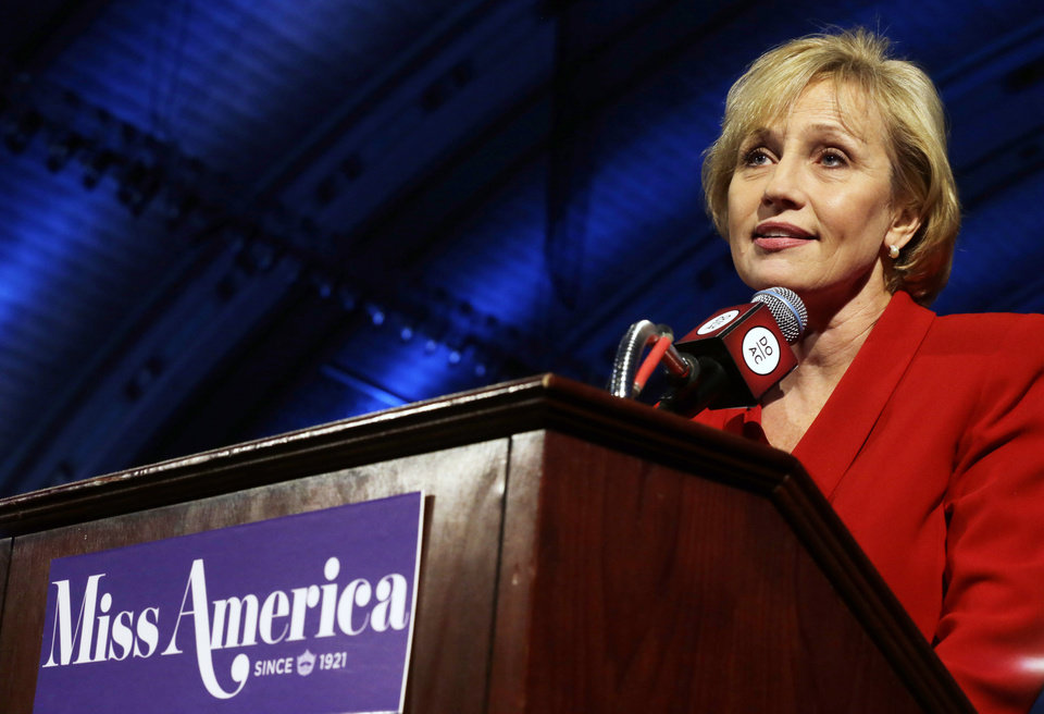Photo - New Jersey Lt. Gov. Kim Guadagno announces that the Miss America pageant is returning to Atlantic City in September after spending six years in Las Vegas, at Atlantic City's Boardwalk Hall Thursday, Feb. 14, 2013, in Atlantic City. (AP Photo/Mel Evans)