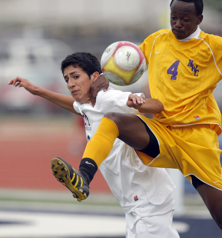 Northwest Classen's Eric Eutingabo and Cascia Hall's Pedro Nava fight for the ball during the boys 5A soccer state championship game between Northwest Classen and Cascia Hall at Edmond North High School in Edmond, Okla., Saturday, May 12, 2012. Photo by Sarah Phipps, The Oklahoman