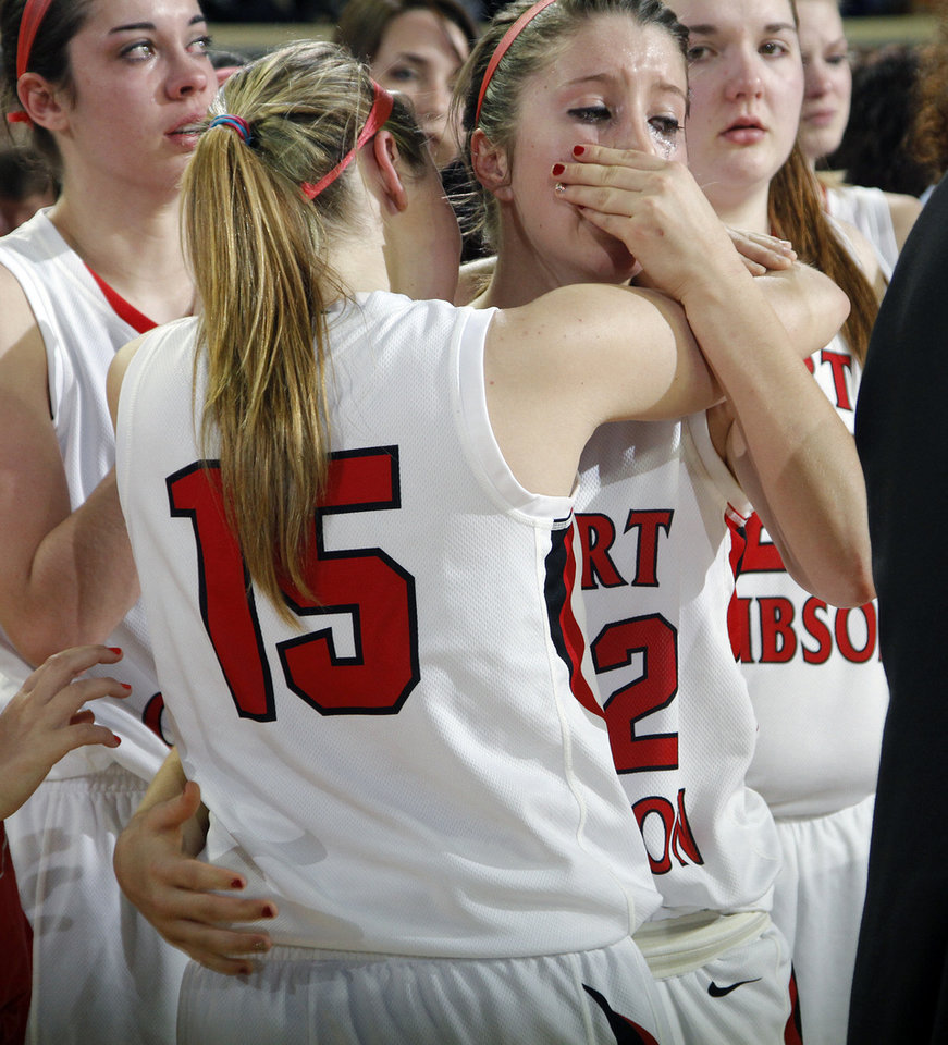Photo - Ft. Gibson's Kirby Parnell (15) and Julia Hill (22) wipe the tears away after the loss to Anadarko during the 4A girls State Basketball Championship game between Ft. Gibson High School and Anadarko High School at State Fair Arena on Saturday, March 10, 2012 in Oklahoma City, Okla.  Photo by Chris Landsberger, The Oklahoman