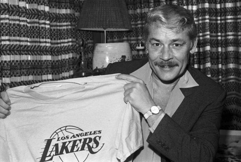 FILE - In this June 18, 1981 file photo, Jerry Buss holds a Los Angeles Lakers shirt in Los Angeles. Buss died Monday, Feb. 18, 2013. Buss, the Lakers' playboy owner who shepherded the NBA franchise to 10 championships, has died. He was 79. Bob Steiner, an assistant to Buss, confirmed Monday, Feb. 18, 2013  that Buss had died in Los Angeles. Further details were not available. (AP Photo/File)