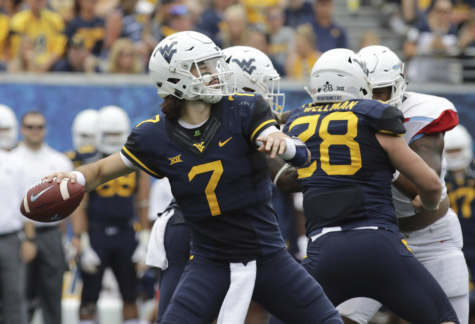 Photo -  West Virginia quarterback Will Grier passed for 3,490 yards and 34 touchdowns in only 11 starts last season. [AP PHOTO]