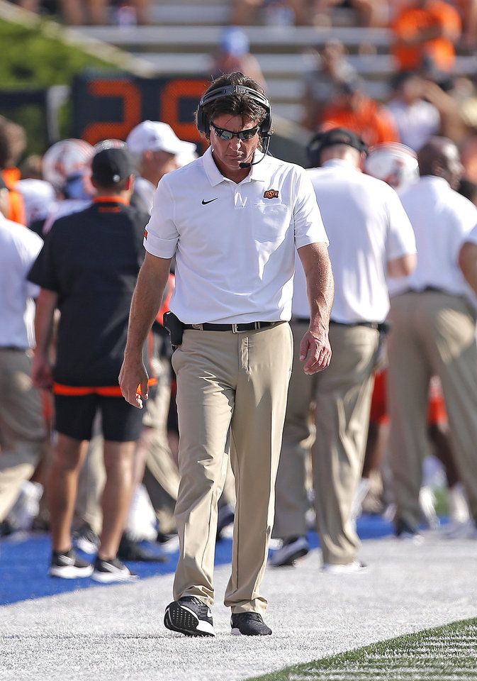 Photo - Oklahoma State head coach Mike Gundy walks the sidelines during a college football game between the Oklahoma State University Cowboys (OSU) and the University of Tulsa Golden Hurricane (TU) at H.A. Chapman Stadium in Tulsa, Okla., Saturday, Sept. 14, 2019. [Sarah Phipps/The Oklahoman]