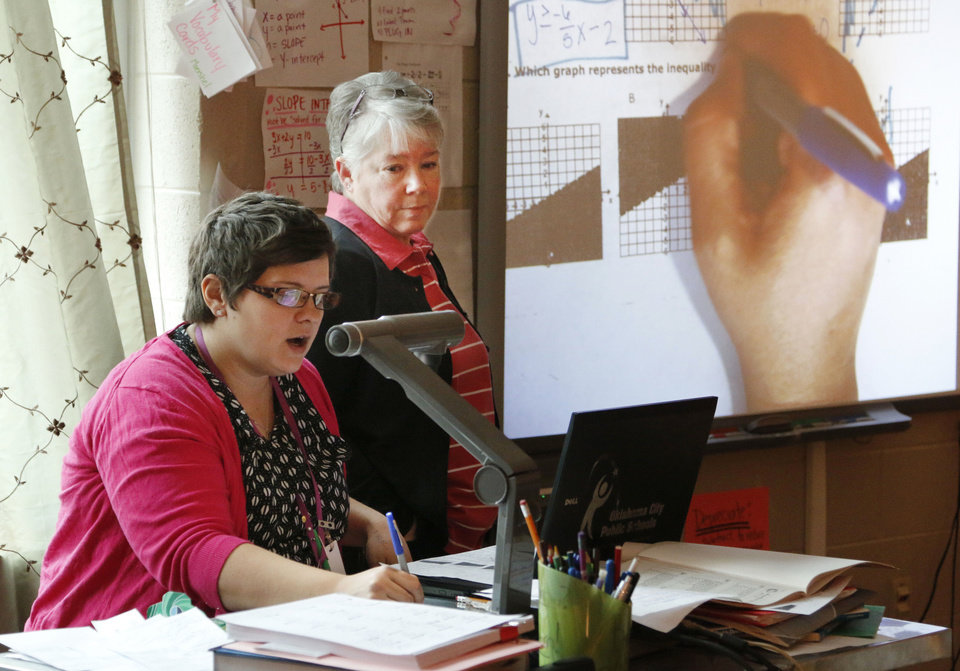 Photo - High school math teachers Cristina Moershel, left, and Susan Pike work  as part of a professional learning community at U.S. Grant High School in Oklahoma City, on Monday.  PAUL HELLSTERN - The Oklahoman