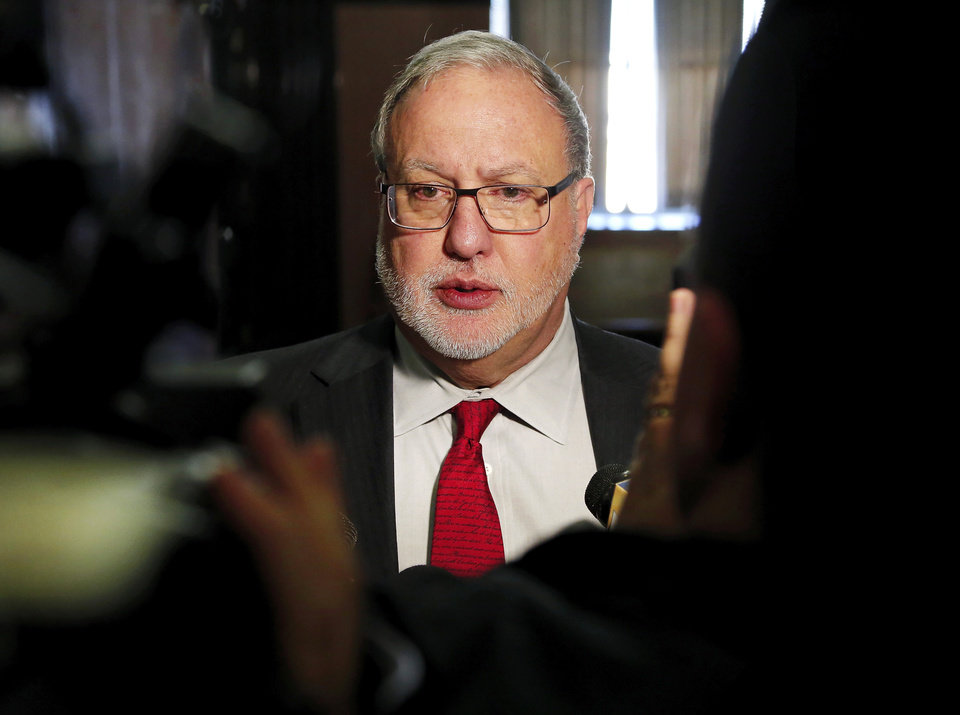 Photo - Defense attorney Doug Friesen answers questions from reporters after his client, Randy Harrison, was found guilty of manslaughter charges in the shooting death of a fleeing teen. Del City police Capt. Randy Trent Harrison, 48, was convicted of first-degree manslaughter in Oklahoma County District Court Tuesday afternoon, Nov. 26, 2013. Harrison shot Dane Scott Jr., 18, in March, 2012, after a high speed pursuit that ended near I-35 and SE 15 Street. The jury recommended a sentence of four years in prison.    Photo by Jim Beckel, The Oklahoman