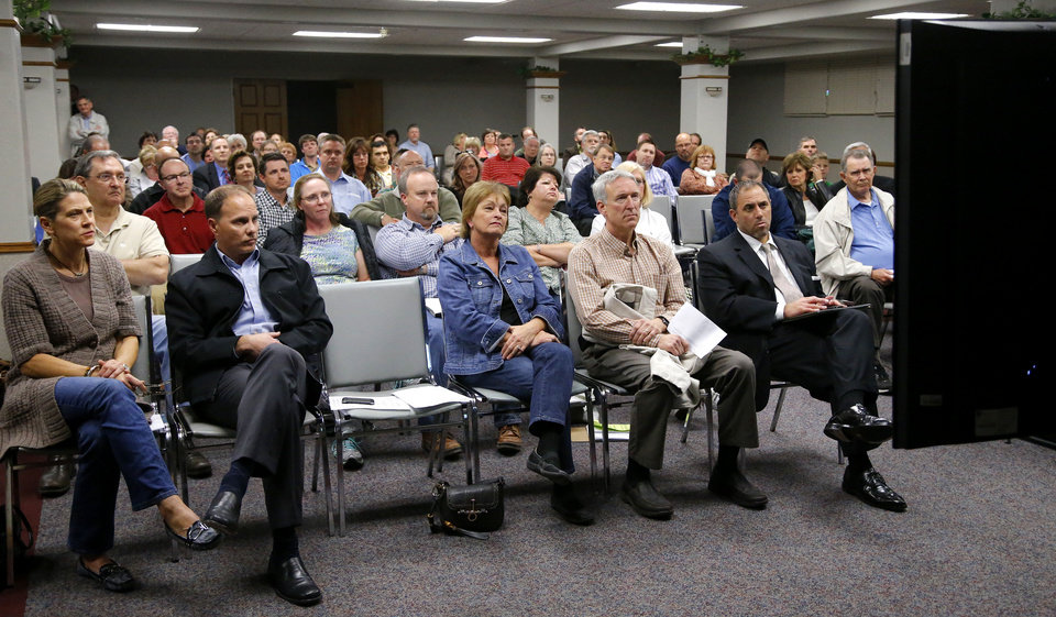 Opponents of the Walmart Neighborhood Market in northwest Edmond watched planning commissioners vote on the development from an overflow room at the Downtown Community Center. PHOTO BY BRYAN TERRY, THE OKLAHOMAN. <strong>BRYAN TERRY - THE OKLAHOMAN</strong>