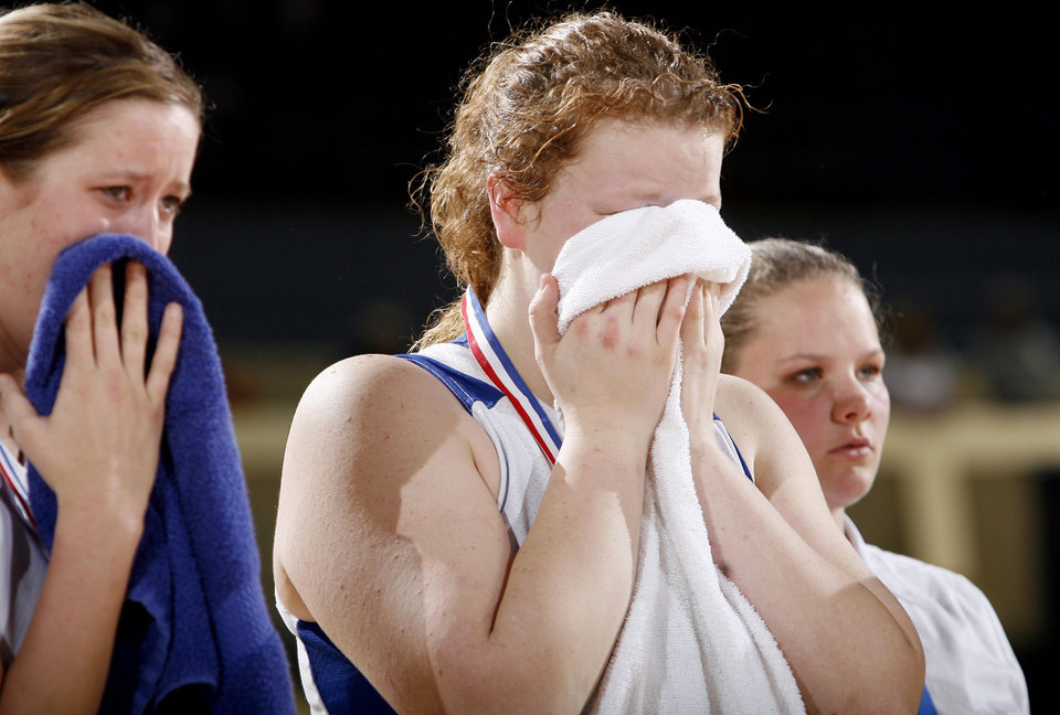 Photo - BOYNTON-MOTON / GIRLS HIGH SCHOOL BASKETBALL / REACTION / CRY / CRYING: Cyril's  Emily Horn, left, and Shelbi Skaggs react to a loss to Boynton during finals of girls Class B basketball state tournament  at the State Fair Arena, Saturday, March 6, 2010, in Oklahoma City. Photo by Sarah Phipps, The Oklahoman  ORG XMIT: KOD