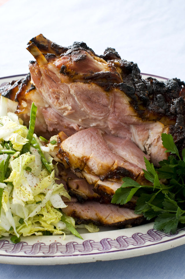 In this image taken on March 11, 2013, hoisin-glazed ham with Napa cabbage-snow pea slaw is shown served on a plate in Concord, N.H. (AP Photo/Matthew Mead) ORG XMIT: NYLS221