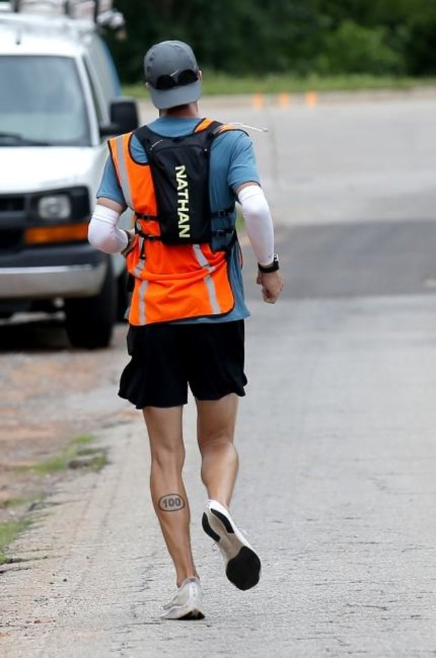 Photo -  James Strahorn runs on North Air Depot Boulevard in Edmond on Tuesday on the second day of his four-day run across Oklahoma. He expects to reach Texas late Thursday after starting on the Kansas border Monday morning. [Sarah Phipps/The Oklahoman]