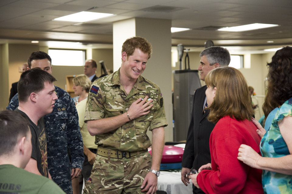 Photo - Wearing his British Army uniform, Britain's Prince Harry visits with wounded warriors undergoing physical therapy and their families at the Military Advanced Training Center at Walter Reed National Military Medical Center in Bethesda, Md., just outside Washington, Friday, May 10, 2013.   (AP Photo/J. Scott Applewhite, Pool)