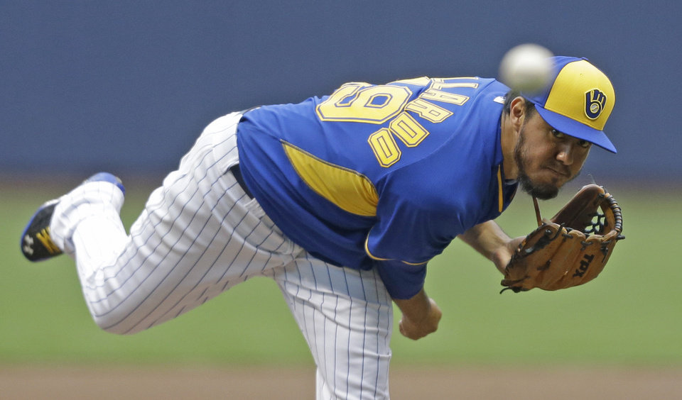 Photo - Milwaukee Brewers starting pitcher Yovani Gallardo throws to the St. Louis Cardinals during the first inning of a baseball game Friday, July 11, 2014, in Milwaukee. (AP Photo/Jeffrey Phelps)