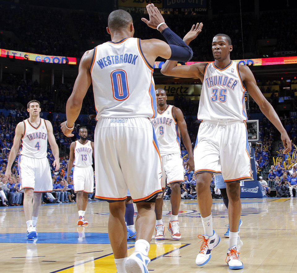 Oklahoma City's Russell Westbrook (0) and Oklahoma City's Kevin Durant (35) celebrate after a Westbrook score during the first round NBA playoff game between the Oklahoma City Thunder and the Denver Nuggets on Sunday, April 17, 2011, in Oklahoma City, Okla. Photo by Chris Landsberger, The Oklahoman