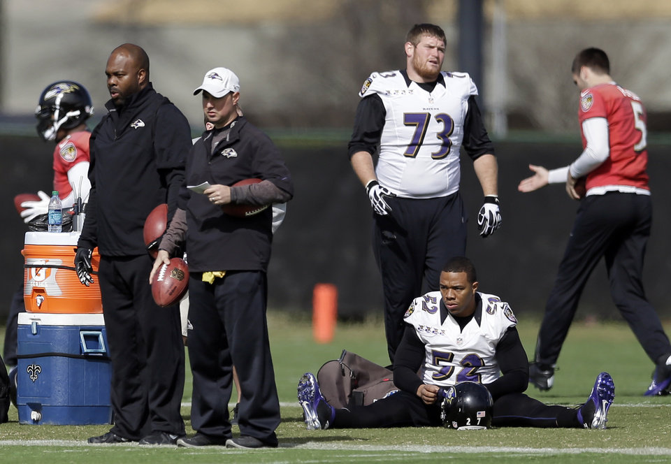 Baltimore Ravens running back Ray Rice, bottom right, and offensive lineman Marshal Yanda, top right, warm up during an NFL Super Bowl XLVII practice on Friday, Feb. 1, 2013, in Metairie, La. The Ravens face the San Francisco 49ers in Super Bowl XLVII on Sunday, Feb. 3. (AP Photo/Patrick Semansky)