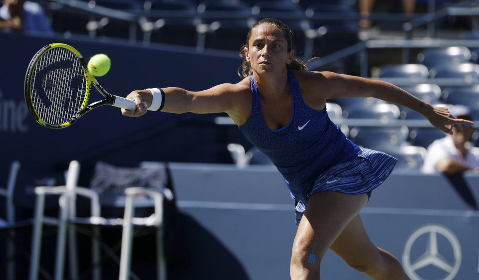 Photo - Roberta Vinci, of Italy, returns a shot against Shuai Peng, of China, during the third round  of the 2014 U.S. Open tennis tournament, Friday, Aug. 29, 2014, in New York. (AP Photo/Frank Franklin II)