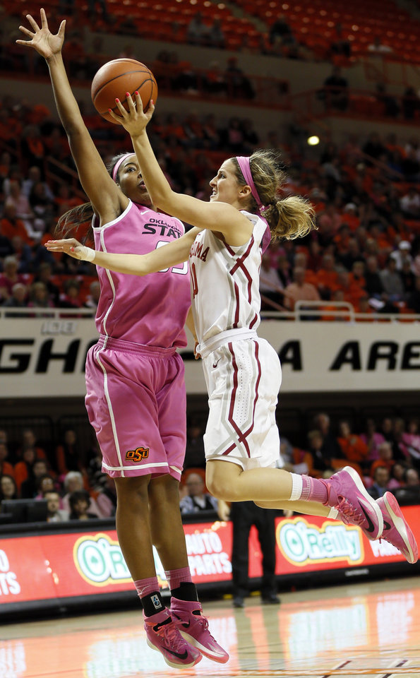 Photo - Oklahoma's Morgan Hook (10) shoots against Oklahoma State's LaShawn Jones (55) in the second half during the women's Bedlam college basketball game between the OU Sooners and the OSU Cowgirls at Gallagher-Iba Arena in Stillwater, Okla., Sunday, Feb. 16, 2014. OSU won, 73-57. Photo by Nate Billings, The Oklahoman