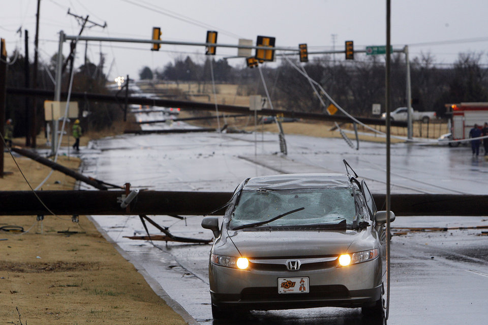 High line poles blown over on a cars on north Penn just south of 150 in Oklahoma City, Tuesday , February 10, 2009.  By David McDaniel, The Oklahoman.