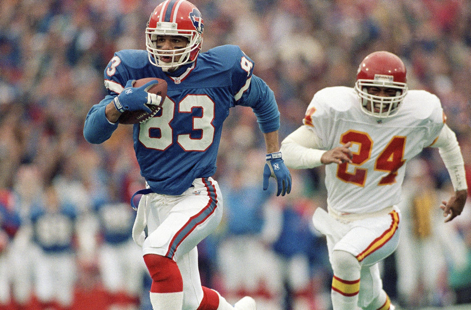 Photo - FILE - In this Jan. 15, 1992, file photo, Buffalo Bills wide receiver Andre Reed runs with the ball during an AFC playoff football game against the Kansas City Chiefs in Orchard Park, N.Y.  Reed awaits induction to the Pro Football Hall of Fame this weekend, and says the eight-year wait didn't feel that long. (AP Photo/Mark Duncan, File)