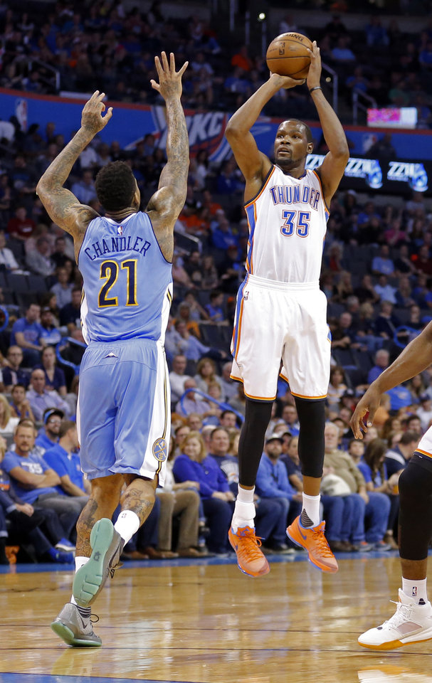 Photo - Oklahoma City's Kevin Durant (35) shoots per Denver's Wilson Chandler (21) during the NBA preseason basketball game between the Oklahoma City Thunder and the Denver Nuggets at Chesapeake Energy Arena, Sunday, October 18, 2015. Photo by Sarah Phipps, The Oklahoman