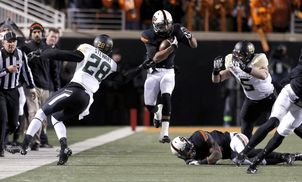 Oklahoma State\'s Josh Stewart (5) tries to get by Baylor\'s Orion Stewart (28) and Baylor\'s Eddie Lackey (5) during a college football game between the Oklahoma State University Cowboys (OSU) and the Baylor University Bears (BU) at Boone Pickens Stadium in Stillwater, Okla., Saturday, Nov. 23, 2013. Photo by Sarah Phipps, The Oklahoman