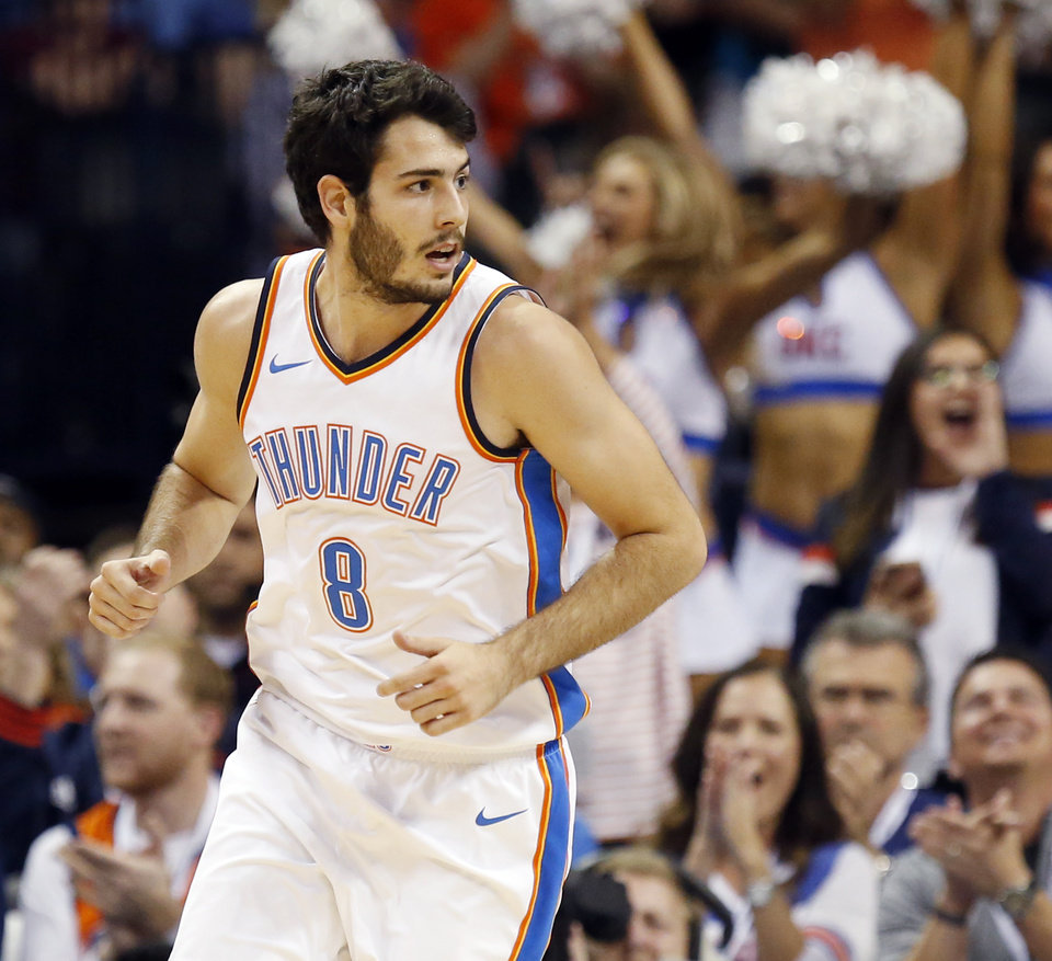 Photo - Oklahoma City's Alex Abrines (8) runs back on defense after making a basket during an NBA basketball game between the Oklahoma City Thunder and the Minnesota Timberwolves at Chesapeake Energy Arena in Oklahoma City, Sunday, Oct. 22, 2017. Minnesota won 115-113. Photo by Nate Billings, The Oklahoman