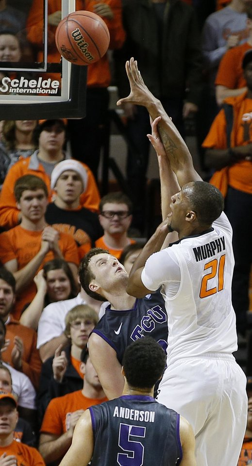 Photo - Oklahoma State's Kamari Murphy (21) shoots over TCU's Hudson Price (21) during an NCAA college basketball game between Oklahoma State University (OSU) and TCU at Gallagher-Iba Arena in Stillwater, Okla., Wednesday, Jan. 15, 2014.  Photo by Bryan Terry, The Oklahoman
