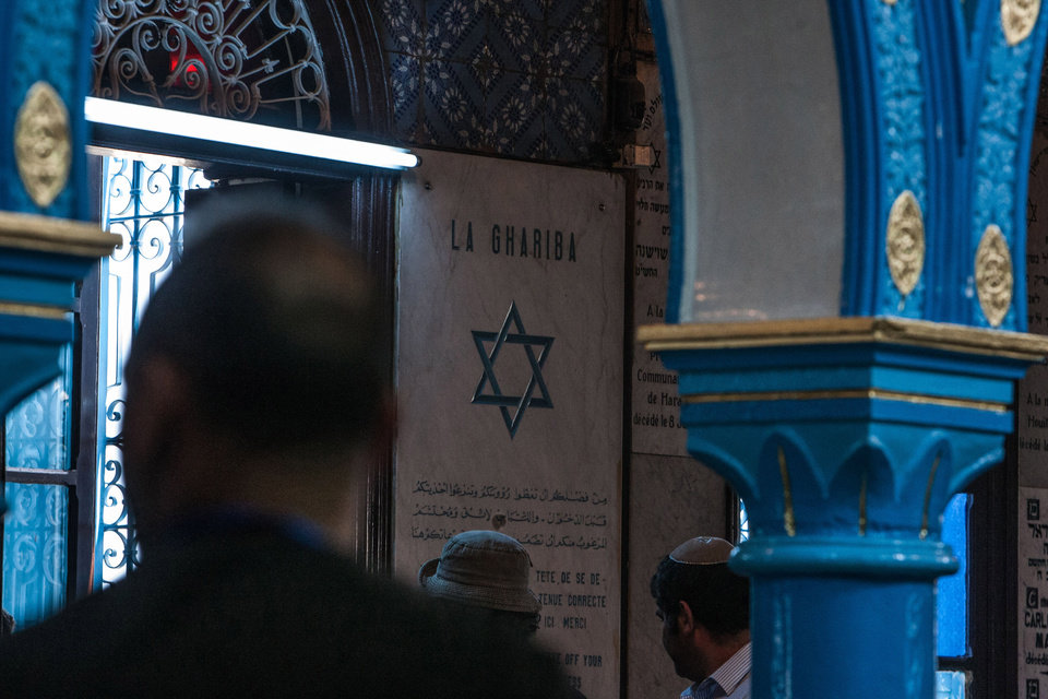 Photo - Jewish pilgrims gather at the Ghriba synagogue, the oldest Jewish monument built in Africa more than 2,500 years ago, to attend the annual Jewish pilgrimage in the resort of Djerba, Tunisia, Friday April 26, 2013. Jews coming from Tunisia, Europe or Israel make their annual pilgrimage to El Ghriba synagogue, commemorating the death of Shimon Bar Yohai, a second-century kabbalistic rabbi who authored a famous religious text known as The Zohar. (AP Photo/Aimen Zine)