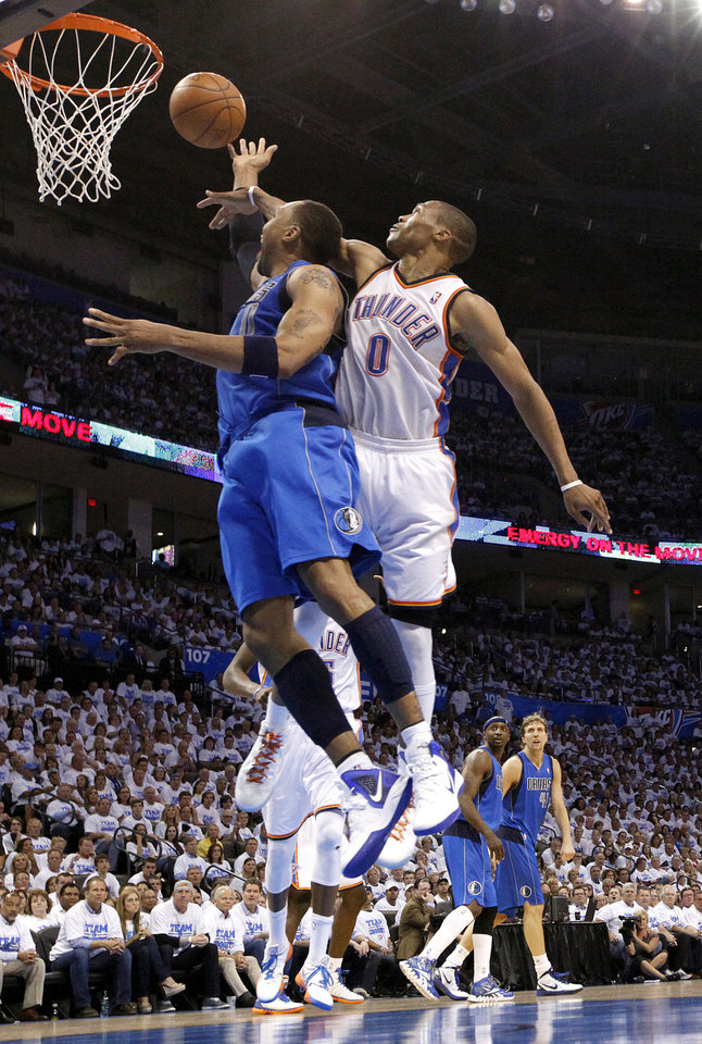 Photo - Oklahoma City's Russell Westbrook (0) defends Dallas' Shawn Marion (0) during Game 2 of the first round in the NBA basketball playoffs between the Oklahoma City Thunder and the Dallas Mavericks at Chesapeake Energy Arena in Oklahoma City, Monday, April 30, 2012. Photo by Sarah Phipps, The Oklahoman