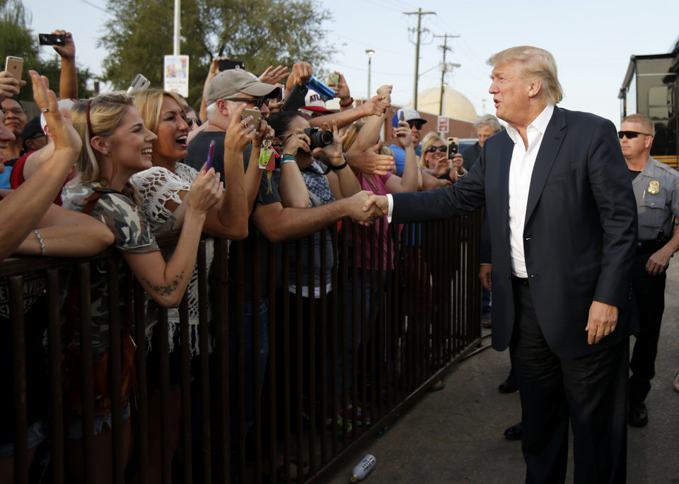 Photo - Donald Trump greets a crowd September 25, 2015 during a rally at the Oklahoma State Fair in Oklahoma City. [Photo by Bryan Terry, The Oklahoman]
