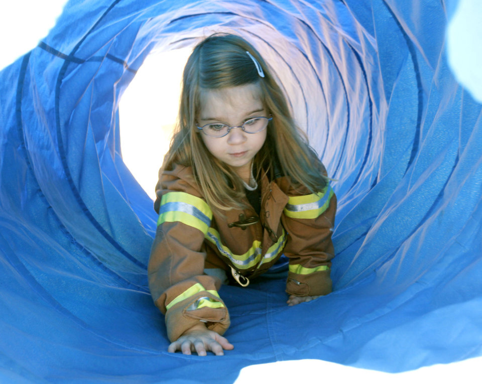 Four-year-old Katya Maile crawls through a tunnel, as the Edmond Fire Department holds its Children's Safety Challenge at the Children's Safety Village in Edmond, OK, Saturday, March 24, 2012,  By Paul Hellstern, The Oklahoman