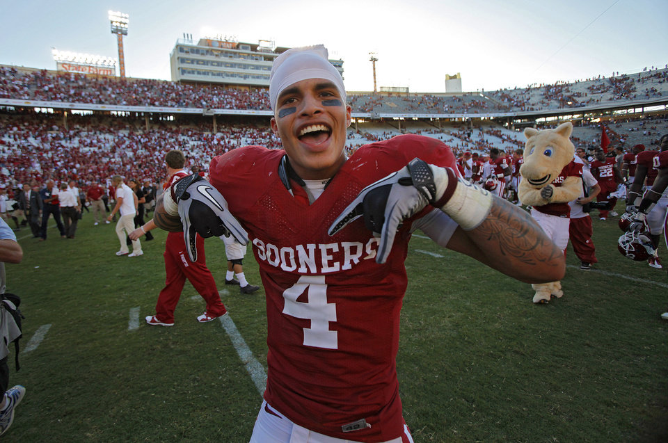 Photo - Oklahoma's Kenny Stills celebrates after the 28-20 win over Texas in the Red River Rivalry college football game between the University of Oklahoma Sooners (OU) and the University of Texas Longhorns (UT) at the Cotton Bowl on Saturday, Oct. 2, 2010, in Dallas, Texas.   Photo by Chris Landsberger, The Oklahoman