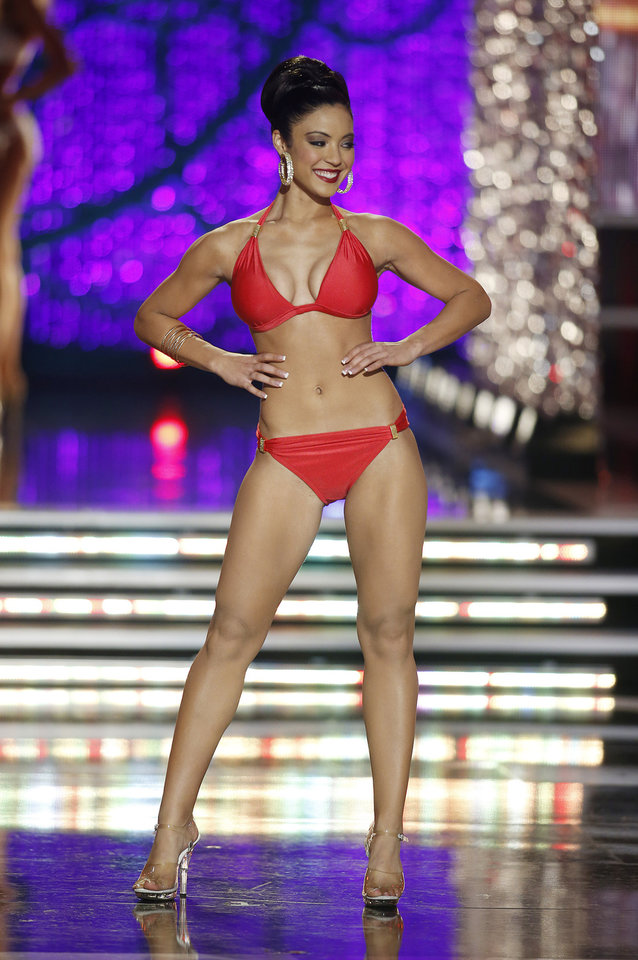 Photo - Miss Iowa Mariah Cary competes in the swimsuit portion of the Miss America 2013 pageant on Saturday, Jan. 12, 2013, in Las Vegas. (AP Photo/Isaac Brekken)