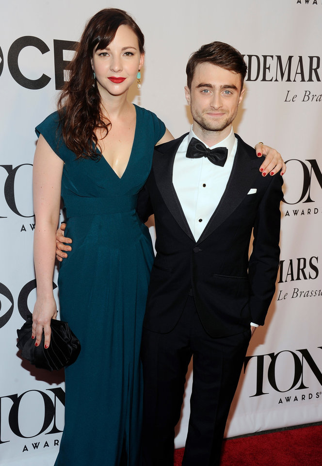 Photo - Daniel Radcliffe, right, and Erin Darke arrive at the 68th annual Tony Awards at Radio City Music Hall on Sunday, June 8, 2014, in New York. (Photo by Charles Sykes/Invision/AP)