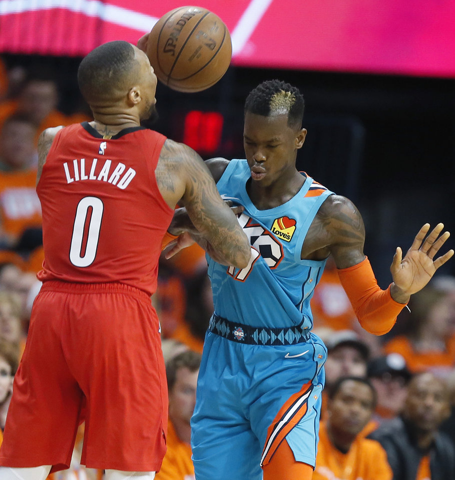 Photo - Oklahoma City's Dennis Schroder (17) foul Portland's Damian Lillard (0) during Game 3 in the first round of the NBA playoffs between the Portland Trail Blazers and the Oklahoma City Thunder at Chesapeake Energy Arena in Oklahoma City, Friday, April 19, 2019. Oklahoma City won 120-108. Photo by Bryan Terry, The Oklahoman
