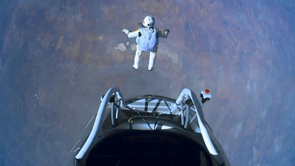 This image made from video, provided by Red Bull Stratos shows pilot Felix Baumgartner of Austria as he jumps out of the capsule during the final manned flight for Red Bull Stratos on Sunday, Oct. 14, 2012. In a giant leap from more than 24 miles up, Baumgartner shattered the sound barrier Sunday while making the highest jump ever � a tumbling, death-defying plunge from a balloon to a safe landing in the New Mexico desert. (AP Photo/Red Bull Stratos)
