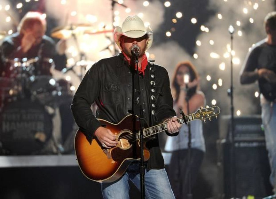 Photo -  Toby Keith performs on stage at the 49th annual Academy of Country Music Awards at the MGM Grand Garden Arena on Sunday, April 6, 2014, in Las Vegas. (AP)
