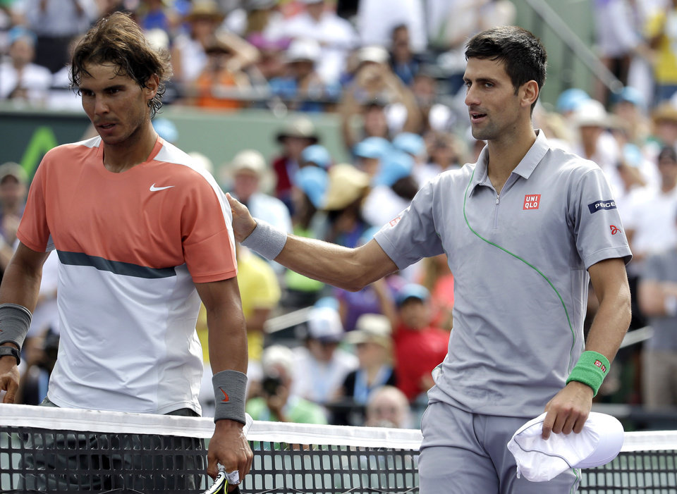 Photo - Rafael Nadal, left, of Spain, meets Novak Djokovic, right, of Serbia, at the net after Djokovic won 6-3, 6-3 in the men's final at the Sony Open Tennis tournament on Sunday, March 30, 2014, in Key Biscayne, Fla. (AP Photo/Lynne Sladky)