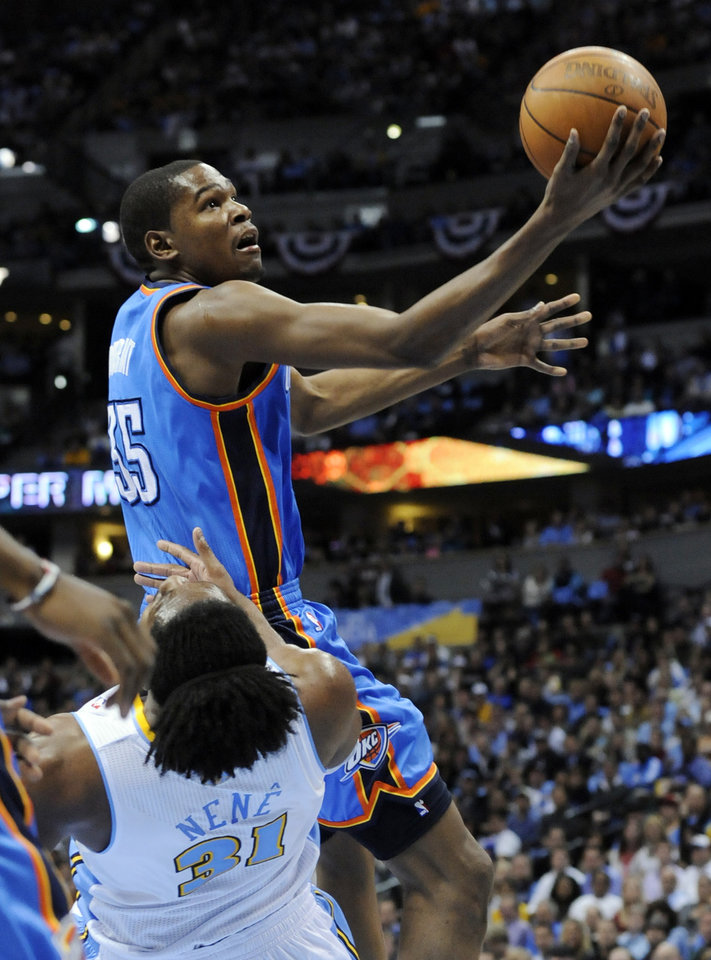 Oklahoma City Thunder forward Kevin Durant (35)  shoots against Denver Nuggets center Nene (31) from Brazil during the first half in game 4 of a first-round NBA basketball playoff series Monday, April 25, 2011, in Denver. (AP Photo/Jack Dempsey)