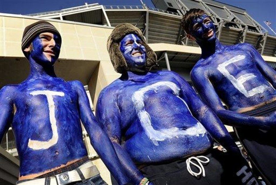 Photo - Decked in Penn State blue and white paint, freshmen Matt Thompson, Killian Kidd and Chris Farion show their support for former Penn State head coach Joe Paterno while being interviewed outside Beaver Stadium on Saturday, November 12, 2011. (AP Photo/Lincoln Journal Star, FRANCIS GARDLER)