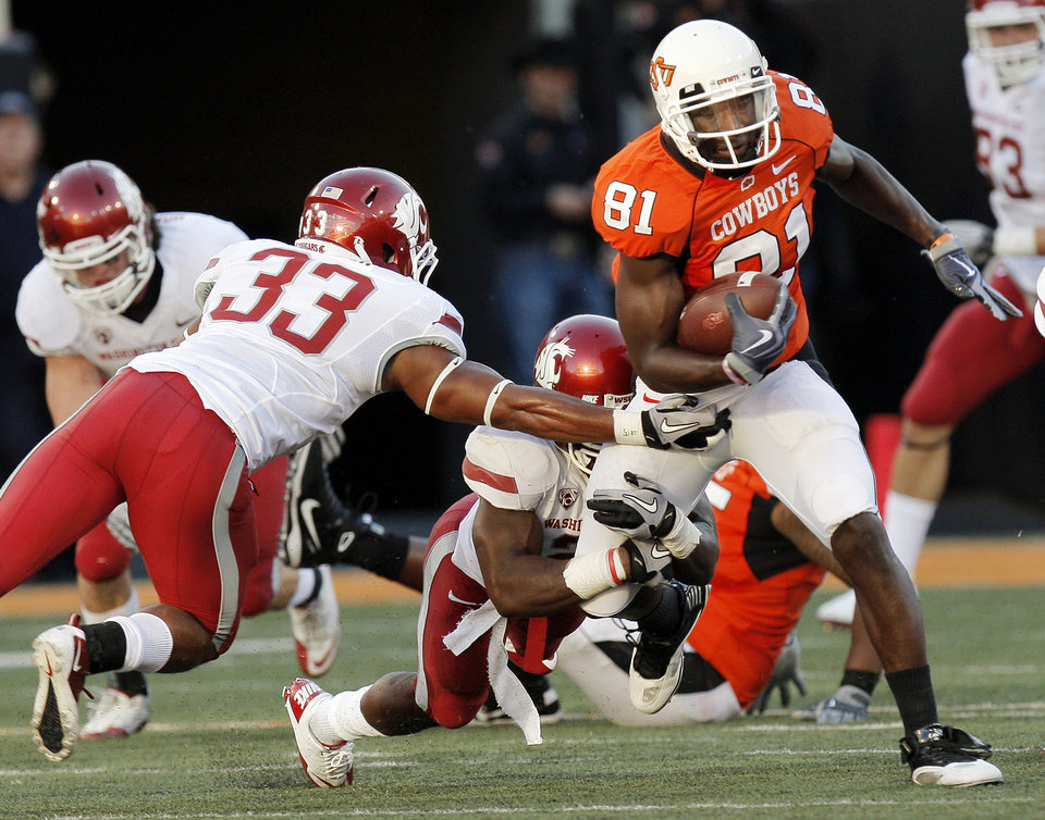 OKLAHOMA STATE UNIVERSITY: WSU\'s Tyree Toomer (33) and Chima Nwachukwu (21) try to bring down OSU\'s Justin Blackmon after a catch in the first quarter during the college football game between the Washington State Cougars (WSU) and the Oklahoma State Cowboys (OSU) at Boone Pickens Stadium in Stillwater, Okla., Saturday, September 4, 2010. Photo by Nate Billings, The Oklahoman