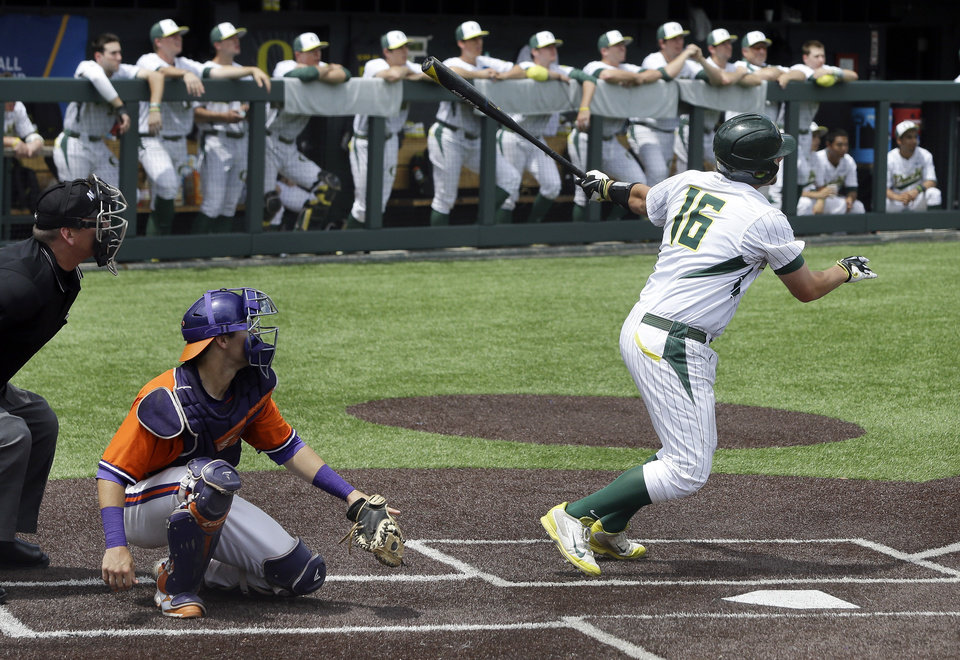Photo - Oregon catcher Shaun Chase (16) watches his three-run home run against Clemson during the fourth inning of an NCAA college baseball regional tournament game Friday, May 30, 2014, in Nashville, Tenn. Catching for Clemson is Chris Okey. (AP Photo/Mark Humphrey)