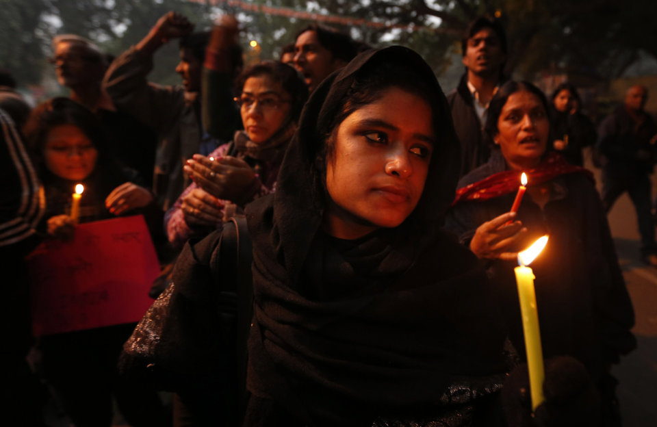 FILE - In this Dec. 26, 2012 file photo, Indians participate in a candle light vigil to seek a quick recovery of the young victim of the recent brutal gang-rape in a bus in New Delhi, India. A statement by Singapore's Mount Elizabeth hospital, where the 23-year-old victim was being treated, said she died Saturday, Dec. 29, 2012. (AP Photo/Saurabh Das, File)