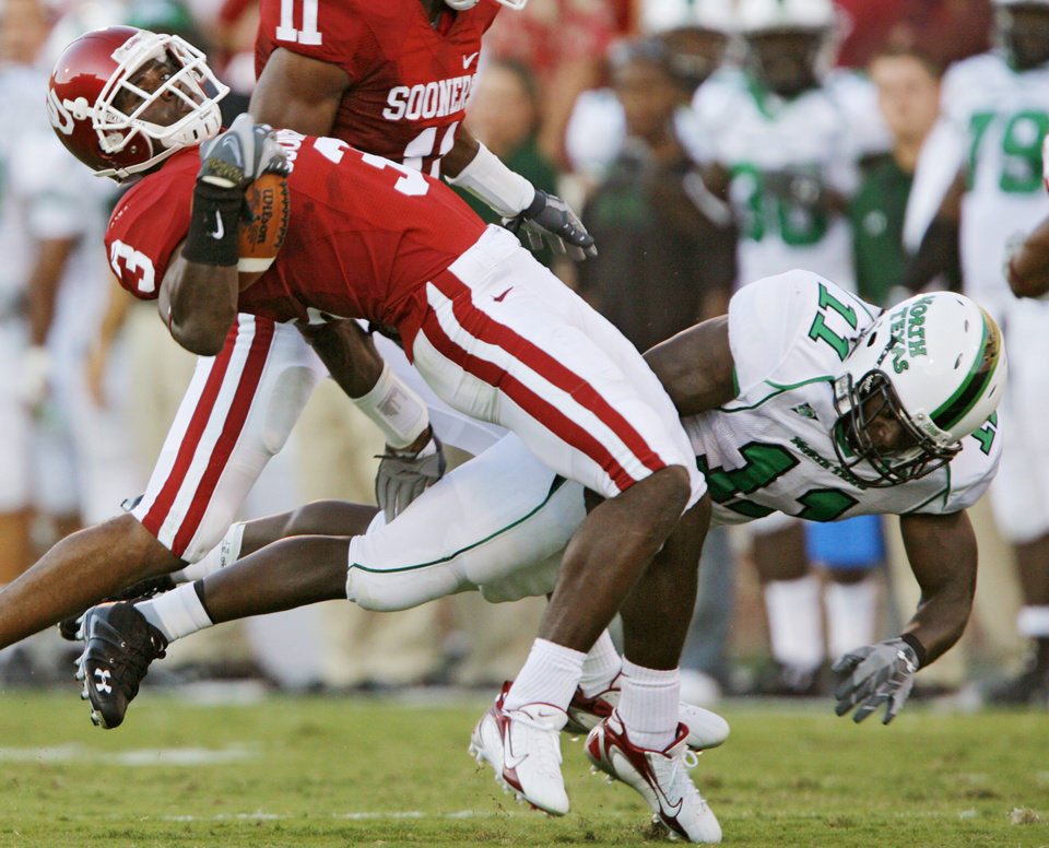 Photo - Oklahoma University's Reggie Smith (3) avoids a tackle by North Texas' Deavin Cox (11) in the first half during the University of Oklahoma Sooners (OU) college football game against the University of North Texas Mean Green (UNT) at the Gaylord Family - Oklahoma Memorial Stadium, on Saturday, Sept. 1, 2007, in Norman, Okla.