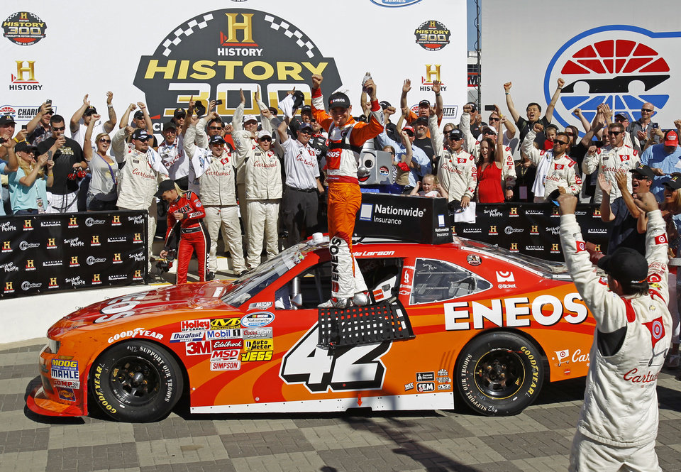 Photo - Kyle Larson celebrates in Victory Lane after winning the NASCAR Nationwide series History 300 auto race at Charlotte Motor Speedway in Concord, N.C., Saturday, May 24, 2014. (AP Photo/Terry Renna)