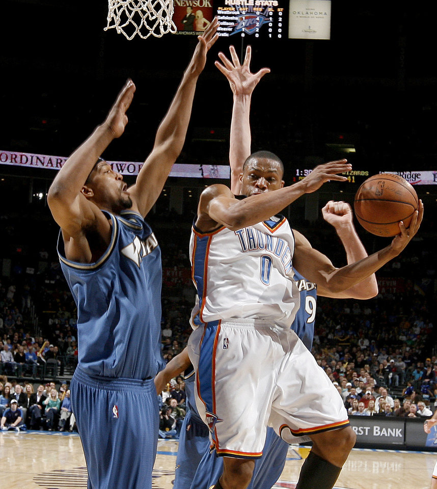 Oklahoma City's Russell Westbrook moves past the Wizards' Dominic McGuire during the NBA basketball game between the Oklahoma City Thunder and the Washington Wizards at the Ford Center in Oklahoma City, Wed., March 4, 2009. PHOTO BY BRYAN TERRY, THE OKLAHOMAN