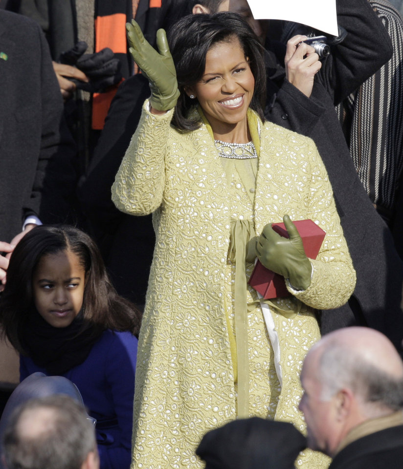 Photo - Michelle Obama arrives for the inauguration ceremony at the U.S. Capitol in Washington, Tuesday, Jan. 20, 2009.  (AP Photo/Jae C. Hong)