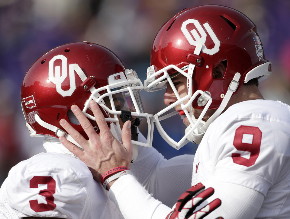 Oklahoma wide receiver Sterling Shepard (3) celebrates with quarterback Trevor Knight (9) after scoring a touchdown during the first half of an NCAA college football game against Kansas State Saturday, Nov. 23, 2013 in Manhattan, Kan. (AP Photo/Charlie Riedel)
