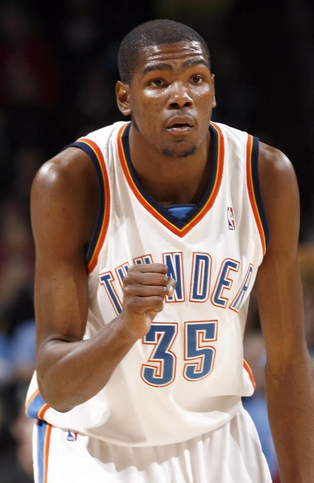 Photo - Oklahoma City's Kevin Durant (35) celebrates a point during the NBA game between the Oklahoma City Thunder and Golden State Warriors, Sunday, Jan. 31, 2010, at the Ford Center in Oklahoma City. Photo by Sarah Phipps, The Oklahoman