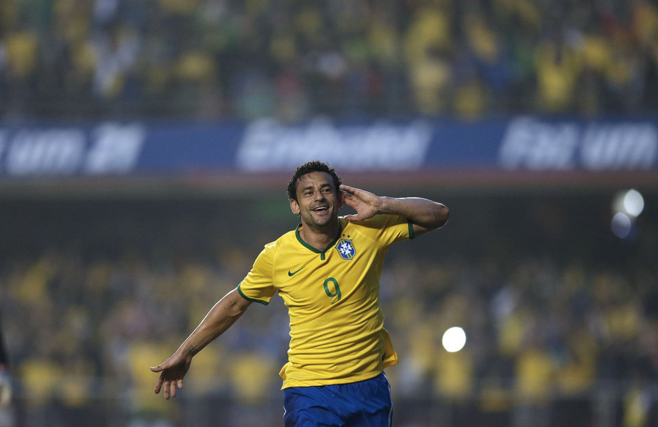 Photo - Brazil's Fred celebrates after scoring against Serbia during a friendly soccer match at Morumbi stadium in Sao Paulo, Brazil, Friday, June 6, 2014. Brazil is hosting the World Cup soccer tournament that starts June 12. (AP Photo/Andre Penner)