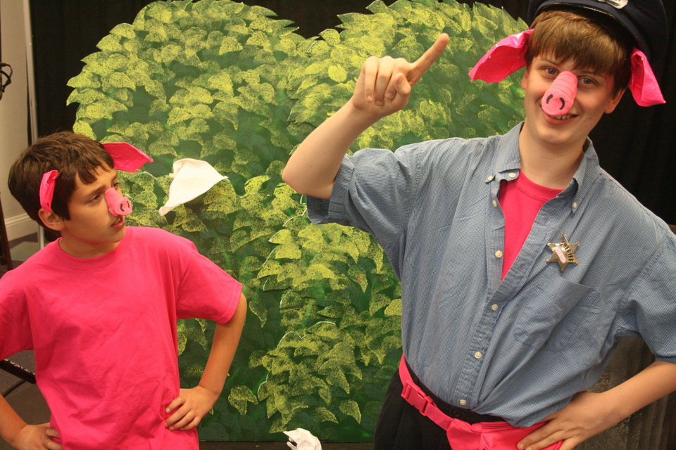 Alex Irwin, left, as Sammy the piglet, and Brady Bell, as his dad, rehearse their parts for �Piggy Nation The Musical.� Photo Provided by Sooner Theatre