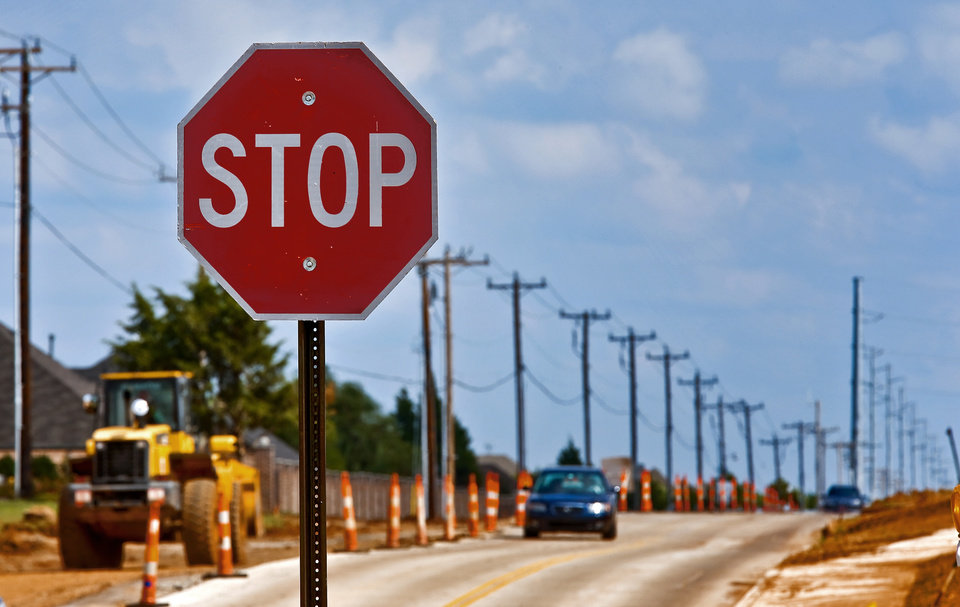Photo - A stop sign pictured at a road expansion project in the OKC metro on Wednesday, Oct. 2, 2013. Photo by Chris Landsberger, The Oklahoman