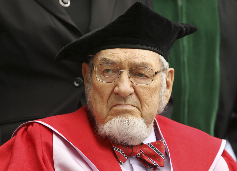 Photo - FILE - In this Sept. 22, 2009 file photo, Dartmouth Alumni and former Surgeon General Dr. C Everett Koop participates in the inauguration ceremony for Dartmouth College's new President Jim Yong Kim in Hanover, N.H.  Koop, who raised the profile of the surgeon general by riveting America's attention on the then-emerging disease known as AIDS and by railing against smoking, died Monday, Feb. 25, 2013, in Hanover. He was 96. (AP Photo/Jim Cole, File)